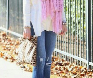 blue ripped jeans, white long sleeve, and white & beige purse image