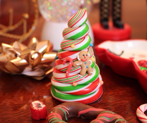 candy cane, gingerbread man, and holiday image