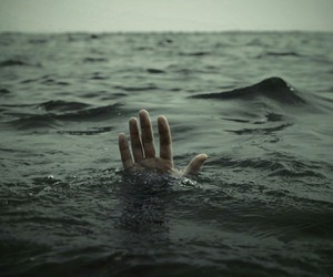 sea, hand, and ocean image
