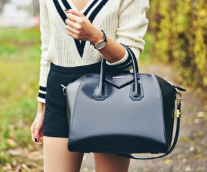 black purse and v neck sweater image