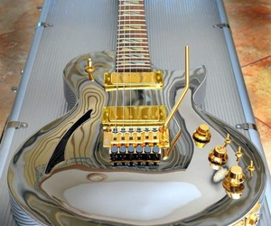 gold, guitar, and instrument image