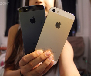 black, gold, and iphone image