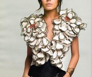 Mila Kunis and flowers image