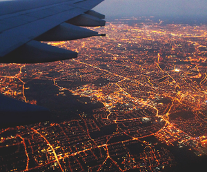 city, light, and airplane image