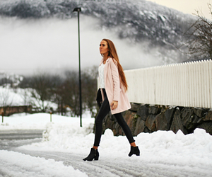 black boots, pink coat, and black jeans image
