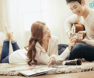 bride, groom, and guitar image