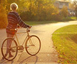 girl, bike, and sweater image