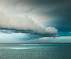 clouds, sea, and sky image