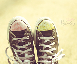 black converse, yellow, and black shoes image