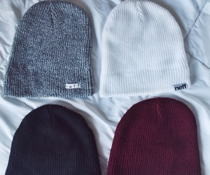 black, white, and beenies image