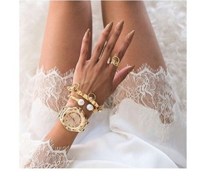 gold watch, gold rings, and white lace dress image