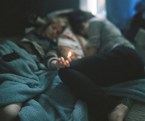 couple, fire, and bed image