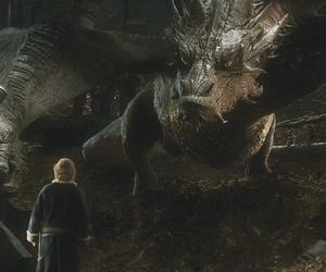 smaug, the hobbit, and bilbo baggins image