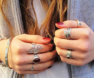 red nails, rings, and hands image