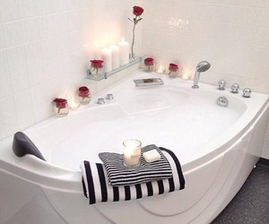 bath, candles, and flowers image