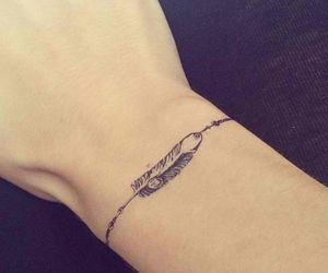 tattoo, bracelet, and feather image