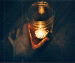 candle, hand, and dark image