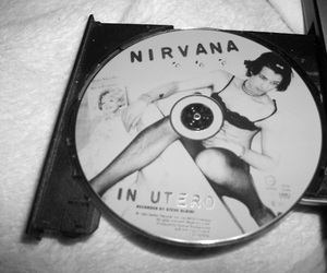black and white, apx, and cd nirvana image