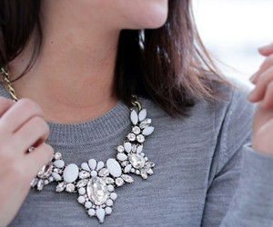 grey sweater, short brown hair, and white statement necklaces image