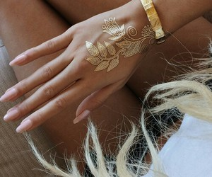 nails, gold, and tattoo image