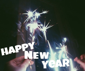 happy new year, new year, and sparkler image