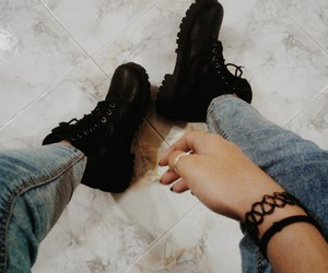 black, blue jeans, and boots image