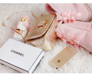 gold iphone, gold purse, and chanel box image