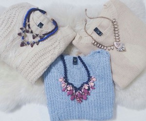 blue sweater, white sweater, and statement necklaces image