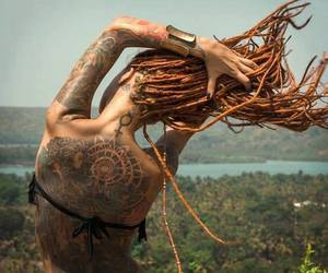 dreadlocks and tattoo image