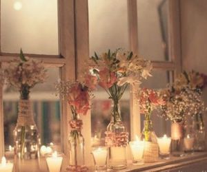 candle, flowers, and bottle image