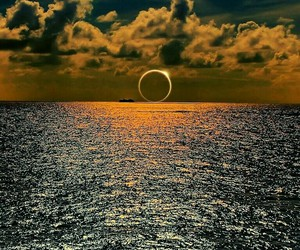 eclipse, sun, and clouds image
