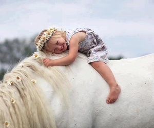 horse, child, and flowers image