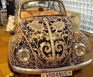 car, beetle, and gold image