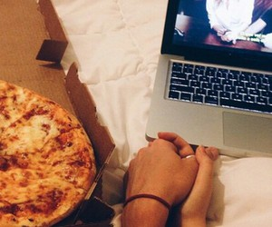 couple, laptop, and pizza image