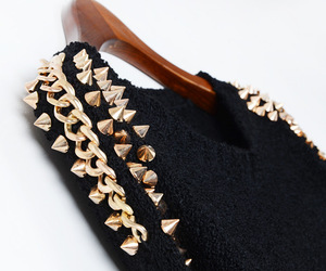 gold, black, and sweater image