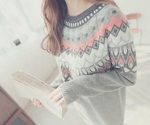 book, brunette, and sweater image