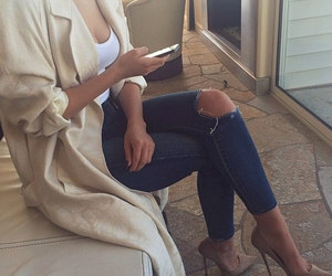 coat, pumps, and ripped jeans image