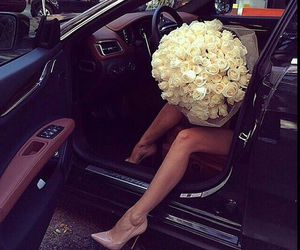 car, flowers, and luxury image