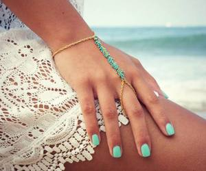 nails, beach, and bracelet image