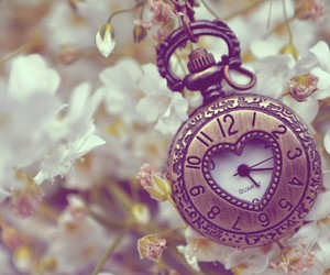 clock, flowers, and time image