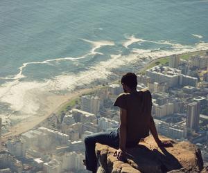 boy, city, and sea image