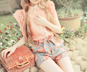 blouse, shorts, and flowers image