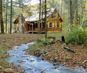 creek and log cabin image
