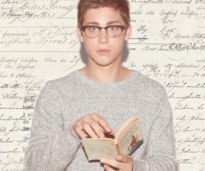 logan lerman, boy, and book image