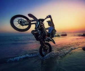sea, sun, and wheelie image