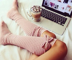 coffee, socks, and laptop image