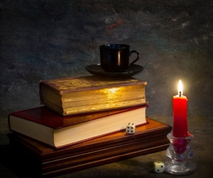 books, candle, and dice image