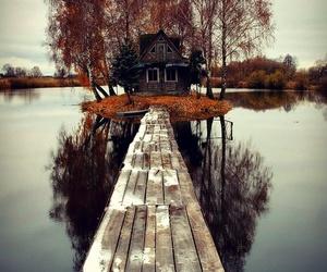 house, lake, and tree image