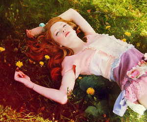 girl, flowers, and grass image