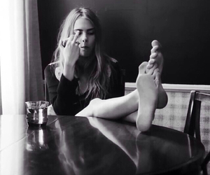 black and white, blonde, and finger image